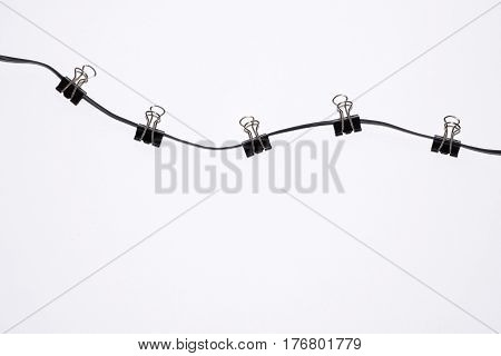office paper clips on rope isolated on white