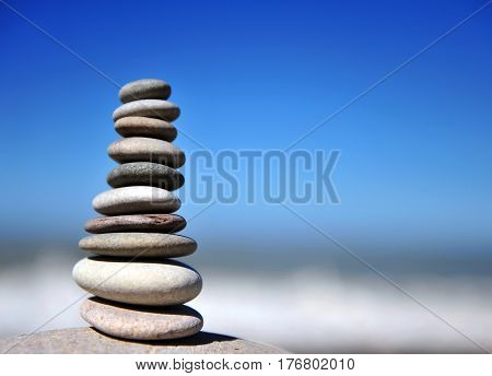 Stones pyramid on the beach on summer