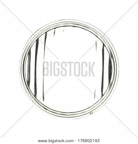 Large round transparent glass from old car headlight isolated on white background.
