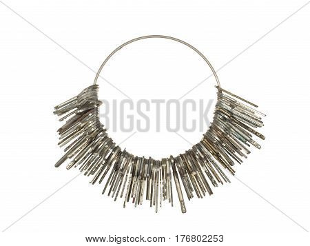 Large bunch of various keys on a metal ring isolated on a white background.