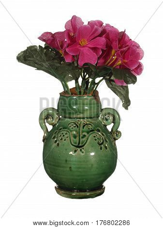 Old ceramic vase green with artificial red flowers isolated on white background.