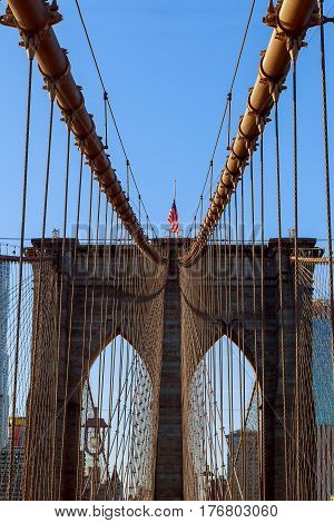 Stars And Stripes Flying On Brooklyn Bridge