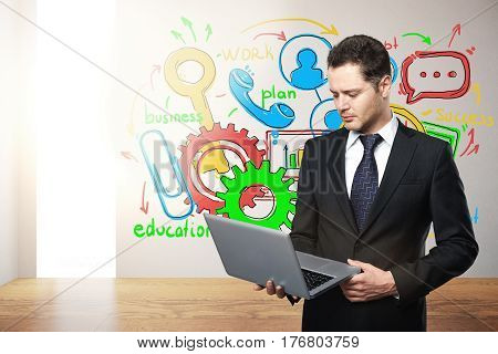 Businessman using laptop in modern interior with business sketch and sunlight. Communication concept. 3D Rendering