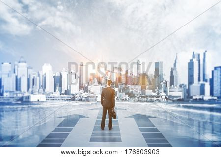 Back view of businessman with forward arrows on creative city and sky with sunlight background. Success concept