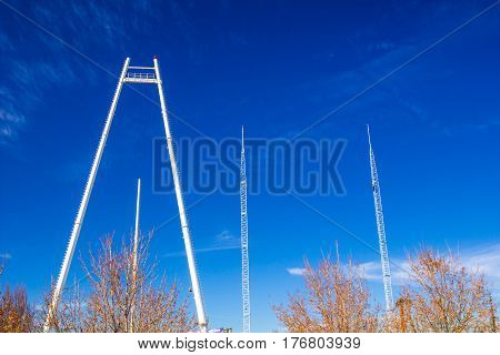 Bungi Tower & Radio Towers Against Blue Sky Background