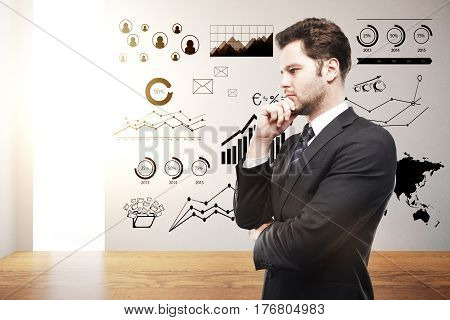 Side portrait of handsome european businessman in clean interior with business charts and sunlight. Finance concept. 3D Rendering