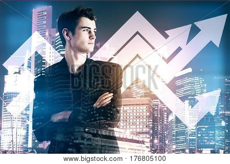 Businessman with abstract upward chart arrows on night city background. Financial growth concept. Double exposure