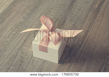 gift in a white box with a pink bow