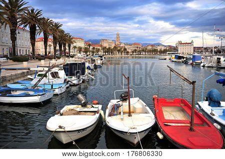 SPLIT CROATIA - FEBRUARY 18: Colorful boats and Split old town Croatia on February 18 2017. Split is a capital of Dalmatia region of Croatia.