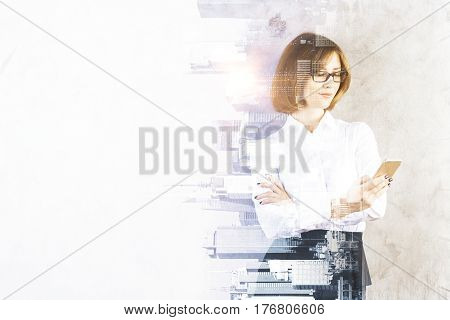 Portrait of attractive young businesswoman using cellphone on abstract sideways city background with copy space and sunlight. Double exposure