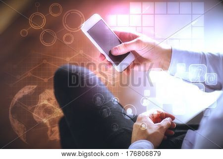 Male hands using smartphone with abstract digital charts and globe. Technology concept