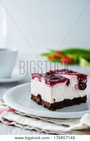 Delicious And Sweet Cheesecake With Cherry Jelly