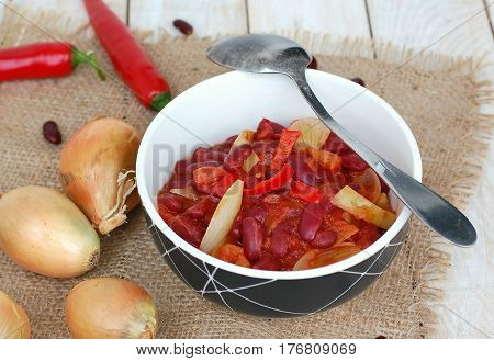 Mexican Chili Beans With Onion, Green Pepper On The Gunny Cloth On Wooden Background