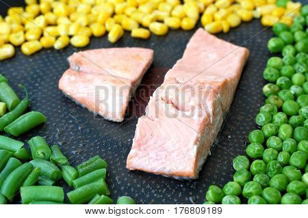 Roasted Salmon Fillet With Yellow Sweet Corn, Green Peas And Bean On The Pan