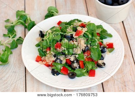 Fresh Healthy Vegan Salad With Quinoa, Corn Salad, Black Olives, Red Pepper And Olive Oil On White P