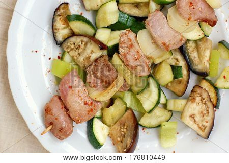 Skewer With Roasted Turkey Hen Meat With Onion, Zucchini And Aubergine On White Plate