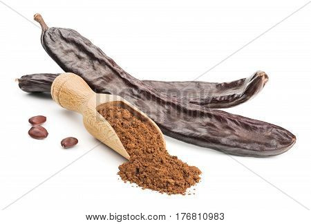 Carob powder and pods isolated on white background. Deep focus