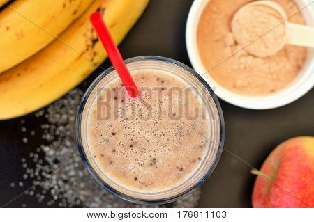 Healthy Fresh Smoothie Drink From Red Apple, Banana Chia Seeds And Plant Protein Powder In The Glass
