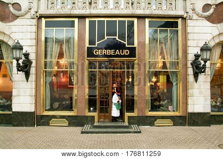 People Coming Out Of The Famous Gerbeaud Coffe Shop
