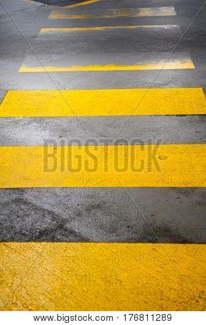 Worn Out Zebra Crossing In Yellow Road Markings
