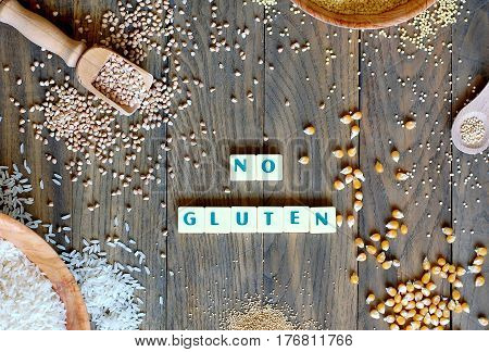 Gluten Free Cereals Corn, Rice, Buckwheat, Quinoa, Millet And Amaranth With Text No Gluten On Grey W