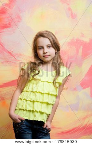 Small Baby Girl With Adorable Face In Yellow Shirt