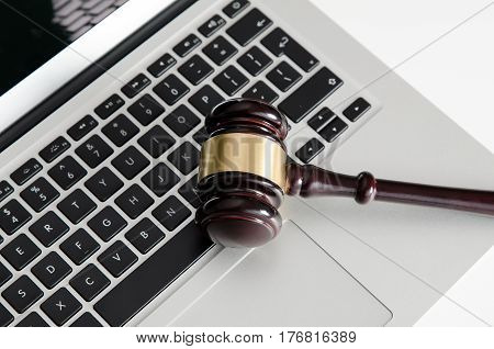 Wooden Gavel On Laptop Keyboard
