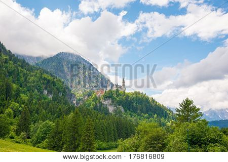 Medieval Castle Neuschwanstein. Around The Blue Sky And The Alps