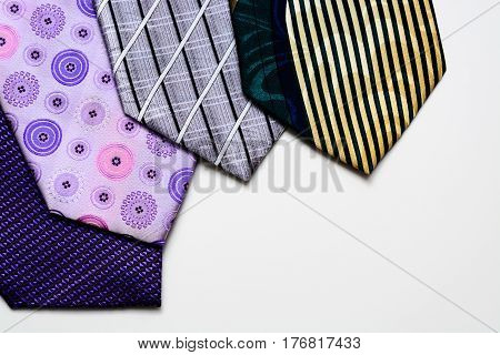 Neckties lie like a fan on white background