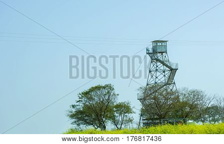 Concept of security. Fire security watchtower border guard.