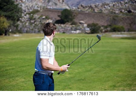 Young Golfer Getting Ready On A Golf Course To Play A Round Of Golf