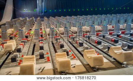 Professional Audio Mixing Console With Faders In Recording Studio
