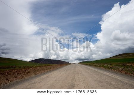 mountain road towards blue sky in the peruvian Andes.
