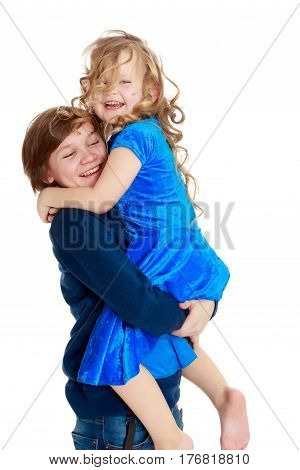 Big brother teen holds the hands of his beloved younger sister.Isolated on white background.