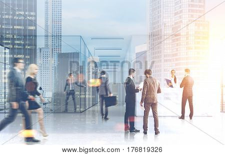 Business people walking in an office lobby with glass walls. There are skyscrapers in the background. 3d rendering toned image double exposure