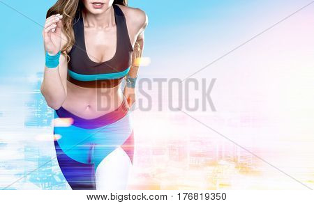 Close up of woman jogger in a black blue and white sportswear against a city background. Toned image double exposure mock up
