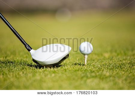 Close Up View Of A Golf Club Driver On A Golf Course With A Golf Ball Ready To Be Driven Down The Fa