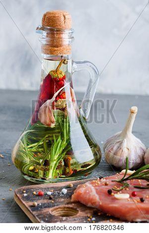 Olive Oil With Garlic Salt Rosemary Pepper In Glass Bottle