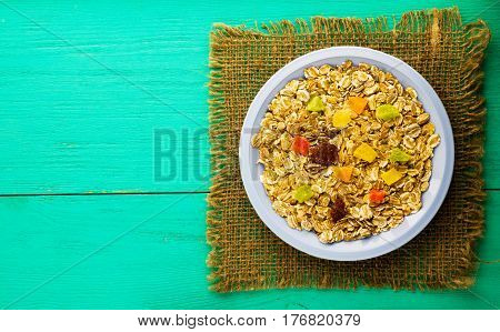 Oatmeal  With  Dried Fruit (strawberries, Grapes, Kiwi, Peach). Muesli On A Wooden Table. Muesli Top