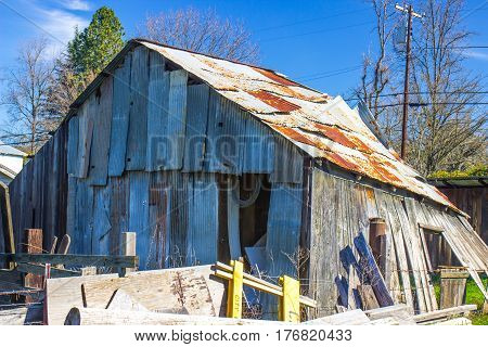 Rear Of Old Tin Sided & Tin Roof Shed