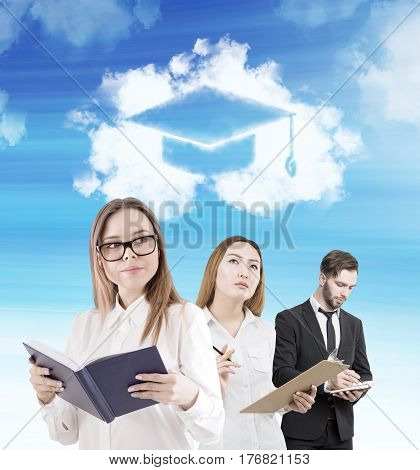 Man and two women are standing with a book a notebook and a clipboard under a cloud with a graduation hat in it. Concept of higher education.