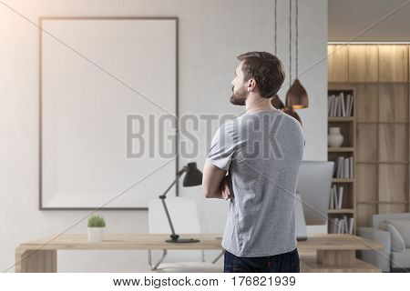 Rear View Of Businessman In Room With Poster