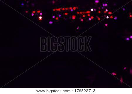 blur lights in black backround bokeh colours
