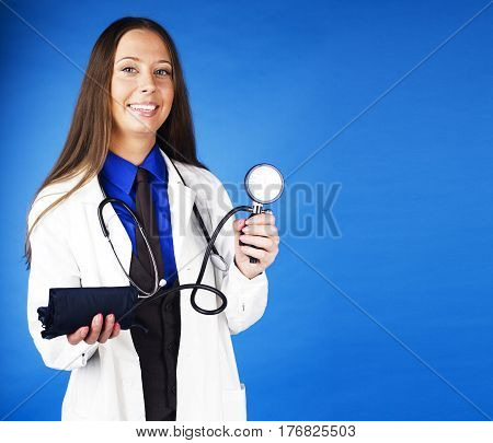 young pretty woman doctor with stethoscope emotional posing, pointing in camers, lifestyle people concept close up