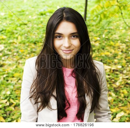 Young cute smiling real stylish dressed woman in green palm park smiling, resting, enjoing, lifestyle outside concept close up