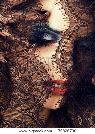 portrait of beauty young woman through lace close up
