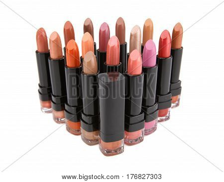 Set of lipstick natural colors isolated on white background. Fashion colorful lipsticks. Professional make up and beauty