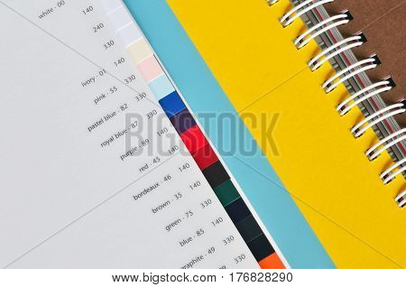Printing color paper sampler with different grammature.