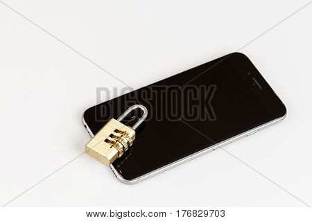 Cell Phone Security - Lock And Phone On White