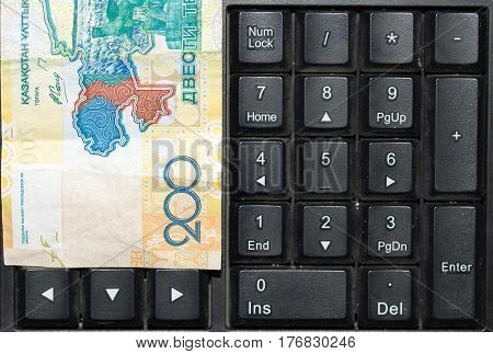 Kazakh tenge on the laptop keyboard . Photo taken by professional camera and lens